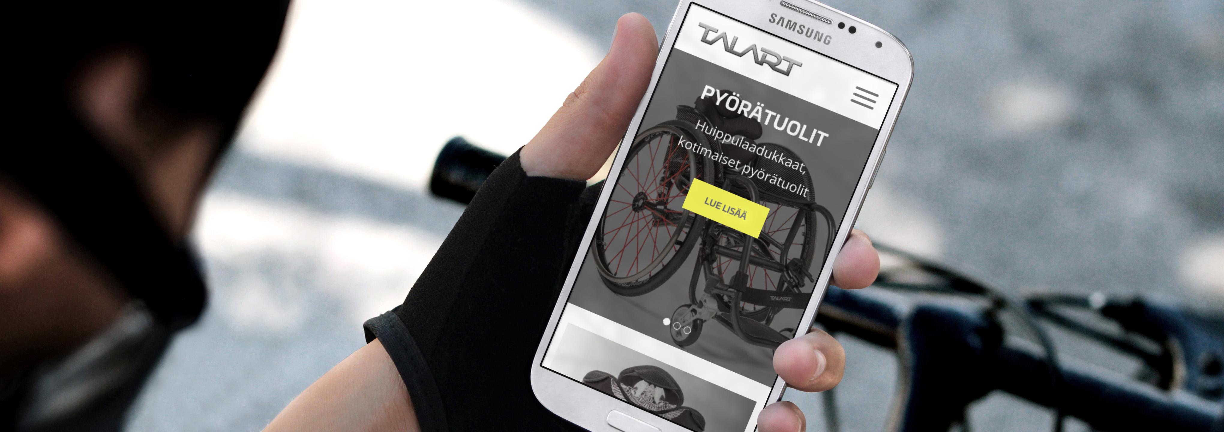 Talart.fi sivuston etusivu älypuhelimen näytöllä.